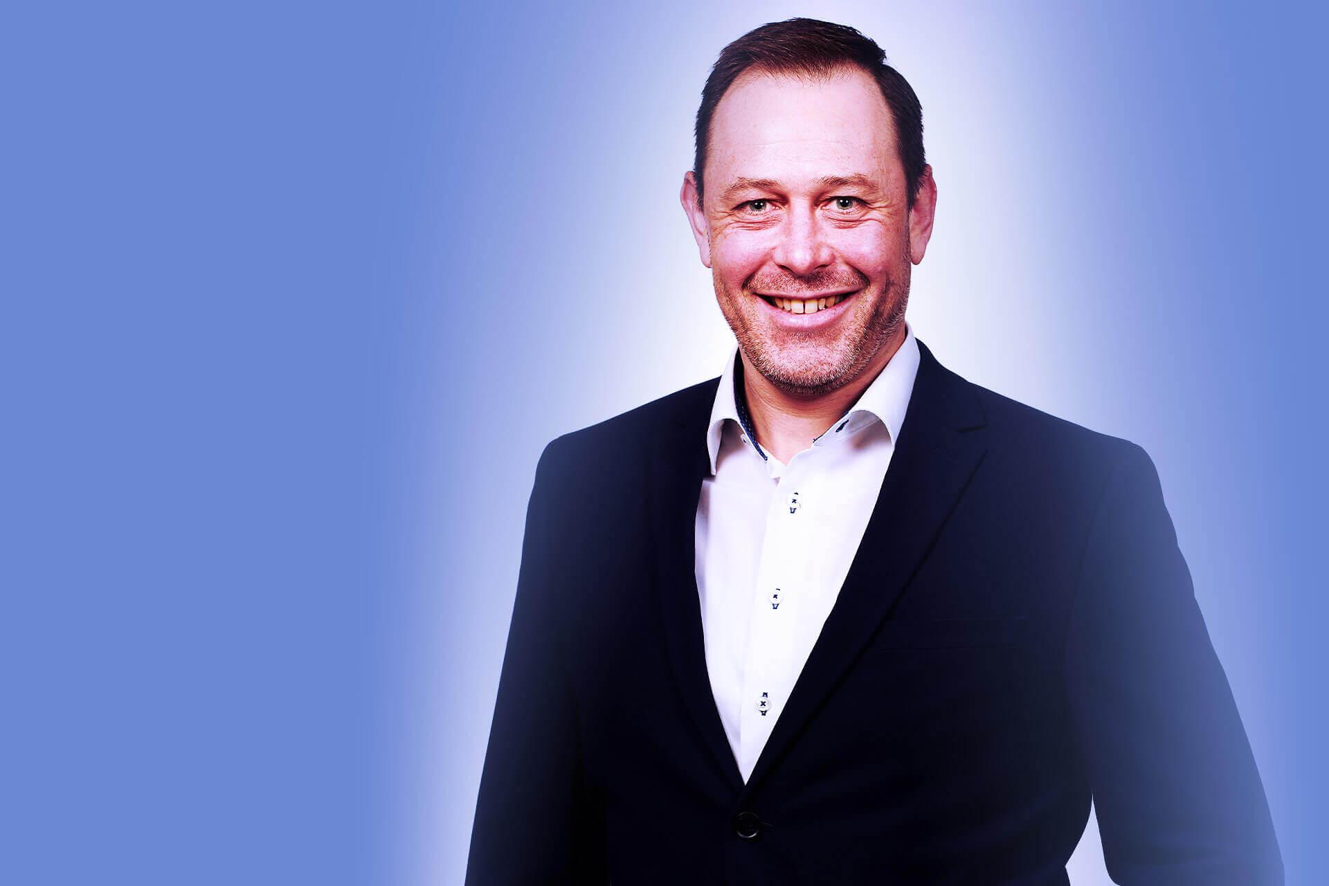 Portraitfoto von Herrn Kössl